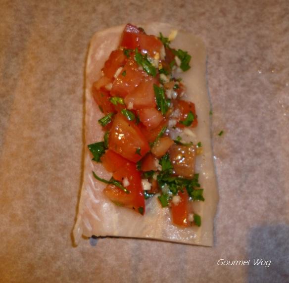 Fish en Papillote with Lemon Garlic Tomato and Parsley sauce